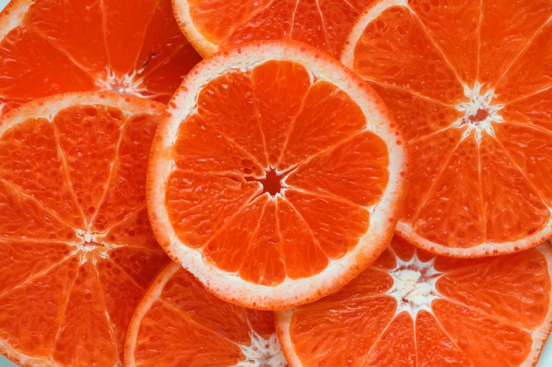 Image is of several slices of an orange citrus fruit, intended as a euphemistic representation of a vulva.
